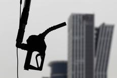 A gasoline pump is seen hanging at a petrol station in central Seoul April 6, 2011.  REUTERS/Lee Jae-Won