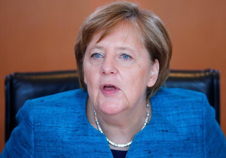 German Chancellor Angela Merkel attends the weekly cabinet meeting at the Chancellery in Berlin, Germany April 12, 2017. REUTERS/Hannibal Hanschke