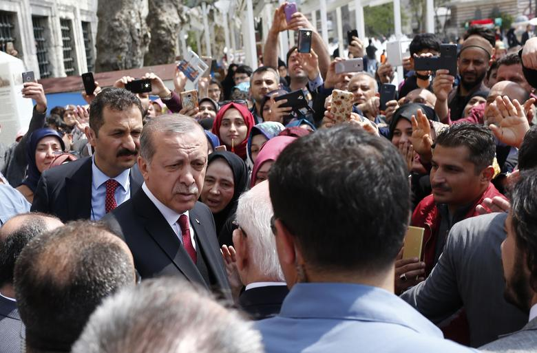 Turkish President Recep Tayyip Erdogan talks to supporters as he leaves Eyup Sultan mosque in Istanbul, Turkey, April 17, 2017. REUTERS/Murad Sezer
