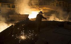 A keeper of blast-furnace number six takes samples of cast iron at the Novolipetsk (NLMK) steel mill in Lipetsk, Russia, August 3, 2015. REUTERS/Maxim Shemetov