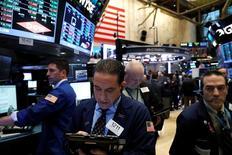 Traders work on the floor of the New York Stock Exchange (NYSE) in New York, U.S., April 17, 2017. REUTERS/Brendan McDermid