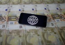 Swift code bank logo is displayed on an iPhone 6s on top of Euro banknotes in this picture illustration made in Zenica, Bosnia and Herzegovina, January 26, 2016. Picture taken January 26. Reuters/Dado Ruvic