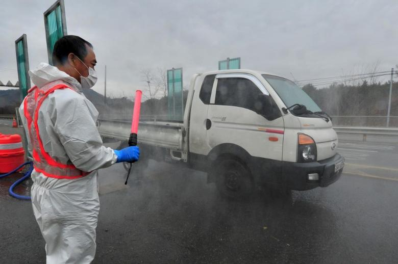 A South Korean health official disinfects a vehicle to prevent spread of bird flu in Pohang, South Korea, December 19, 2016. Choi Chang-ho/News1 via REUTERS/Files
