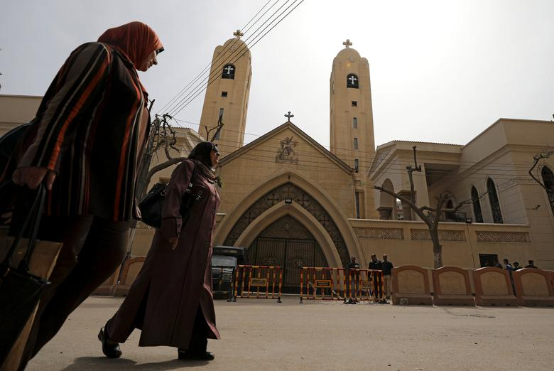 Women pass by the Coptic church that was bombed on Sunday in Tanta, Egypt, April 10, 2017. REUTERS/Mohamed Abd El Ghany