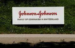 The logo of healthcare company Johnson & Johnson is seen in front of an office building in Zug, Switzerland July 20, 2016.     REUTERS/Arnd Wiegmann  - RTSKPXP