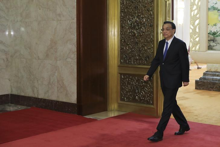 Chinese Premier Li Keqiang arrives to meet with Serbian President Tomislav Nikolic at the Great Hall of People in Beijing, China March 31, 2017. REUTERS/Lintao Zhang/Pool