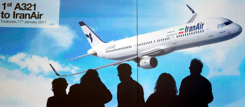 FILE PHOTO: Shadows of Airbus members are seen in silhouette in front of a poster of an A321 as IranAir takes delivery of the first new Western jet under an international sanctions deal in Colomiers, near Toulouse, France, January 11, 2017.   REUTERS/Regis Duvignau/File Photo