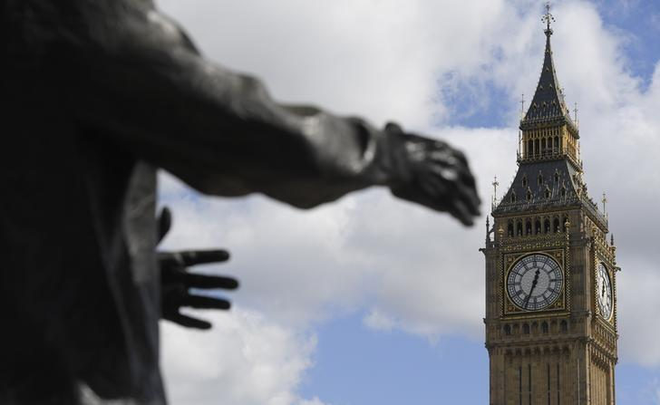 The arms of the Winston Churchill statue in Parliament Square appear to reach out towards the Big Ben clock tower above the Houses of Parliament in central London, Britain April 18, 2017.  REUTERS/Toby Melville/Files