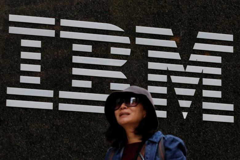 A woman passes by the IBM offices in New York City, U.S., October 17, 2016.  REUTERS/Brendan McDermid  -