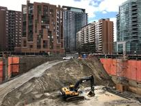 FILE PHOTO: Construction equipment is parked at the bottom of a pit on the site of a new condominium complex off Redpath Avenue in Toronto, Ontario, Canada April 1, 2017. Picture taken April 1, 2017.  REUTERS/Chris Helgren/File Photo