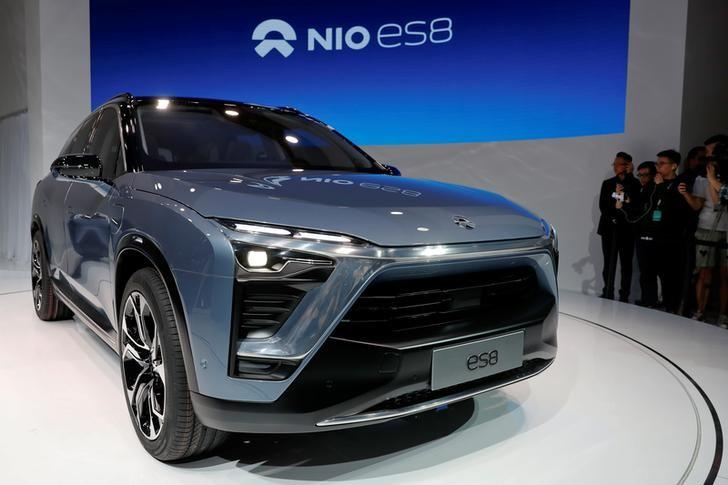 People gather at the booth of Chinese electric vehicle start-up Nio as it unveils its ES8 SUV at the Shanghai autoshow, in Shanghai, China April 19, 2017. REUTERS/Aly Song