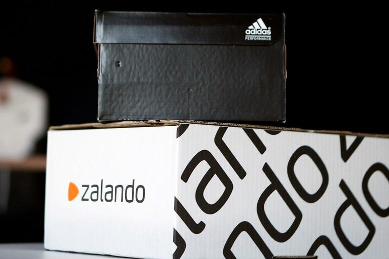 A Adidas shoebox stands above a Zalando cardboard box on a staged scene in Berlin, Germany June 8, 2016. REUTERS/Axel Schmidt/File Photo