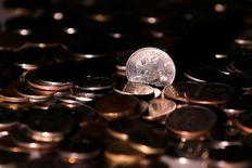 Russian rouble coins are seen in this picture illustration taken June 7, 2016. REUTERS/Maxim Zmeyev/Illustration