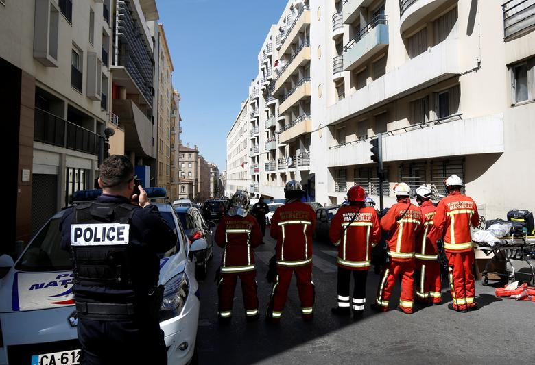 French firefighters secure the street as police conduct an investigation after two Frenchmen were arrested in Marseille, France, April 18, 2017 for planning to carry out an ''imminent and violent attack'' ahead of the first round of the presidential election on Sunday, France's interior minister said.   REUTERS/Philippe Laurenson