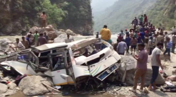 People and police gather at the site where a bus fell off a mountain road in Shimla, Himachal Pradesh, India April 19, 2017 in this still image taken from video.  ANI via Reuters TV