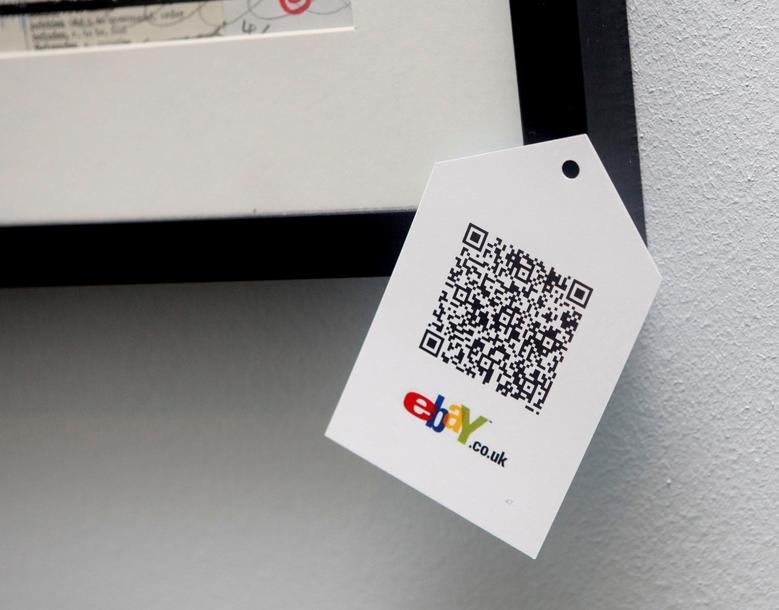 FILE PHOTO: A QR code is seen on goods for sale during the launch of a temporary ''pop-up'' Christmas shop run by online giant eBay on Dean Street in Soho, central London November 29, 2011.  REUTERS/Neil Hall/File Photo