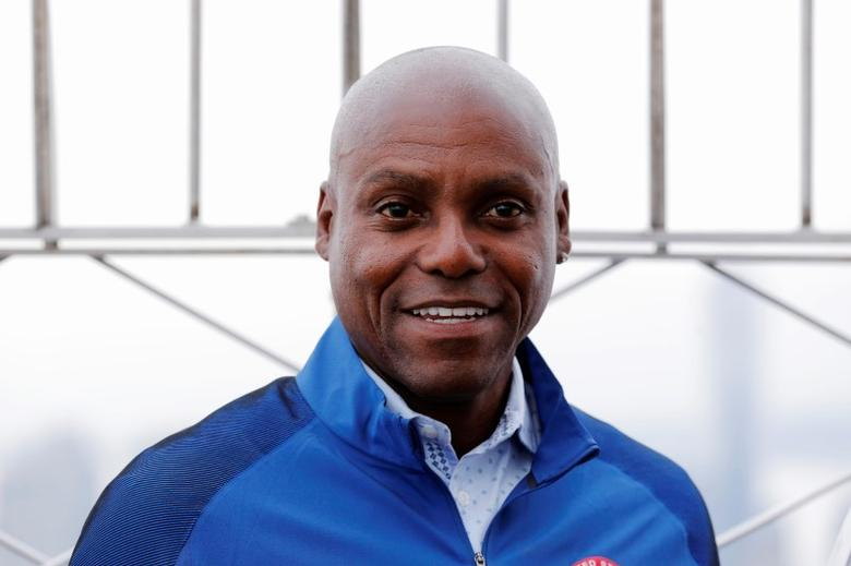 FILE PHOTO - Former Olympic athlete Carl Lewis smiles for photographs on the observation deck of the Empire State Building to celebrate 100 days until the 2016 Olympic Games, in New York, U.S., April 27, 2016. REUTERS/Lucas Jackson