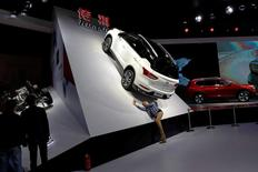 A woman takes pictures of the Trumpchi GS4 from GAC Group, displayed at the Shanghai Auto Show, in Shanghai, China April 20, 2017. REUTERS/Aly Song