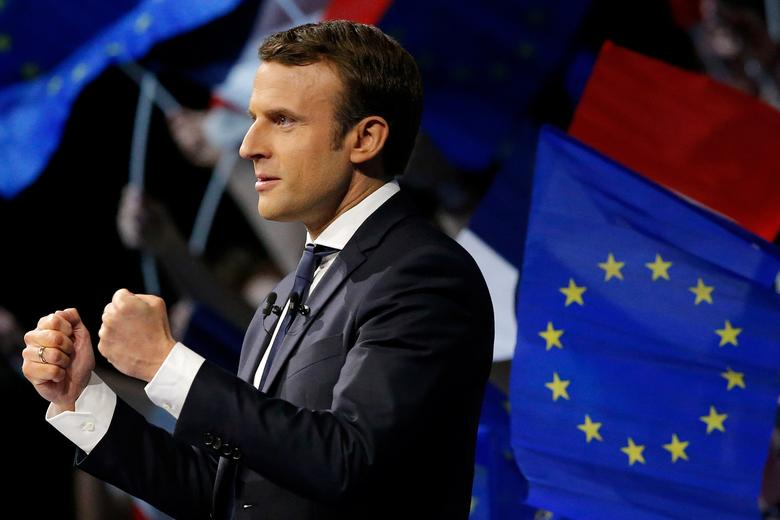 FILE PHOTO: Emmanuel Macron, head of the political movement En Marche!, or Onwards!, and candidate for the 2017 presidential election attends a campaign political rally in Saint-Herblain near Nantes, France, April 19, 2017. REUTERS/Stephane Mahe