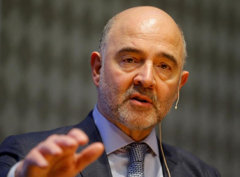 FILE PHOTO:  European Economic and Financial Affairs Commissioner Pierre Moscovici delivers a keynote speech ahead of an Austrian National Bank panel discussion in Vienna, Austria, February 16, 2017.    REUTERS/Heinz-Peter Bader/File Photo