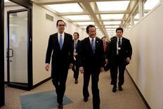 U.S. Treasury Secretary Steven Mnuchin (L) and Japanese Finance Minister Taro Aso walk after their meeting during the IMF/World Bank spring meetings in Washington, U.S., April 20, 2017. REUTERS/Yuri Gripas
