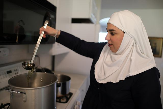 California ''weed nun'' Desiree Calderon, who goes by the name Sister Freya, ladles CBD salve made from hemp at Sisters of the Valley near Merced, California, U.S., April 18, 2017. Picture taken April 18, 2017. REUTERS/Lucy Nicholson