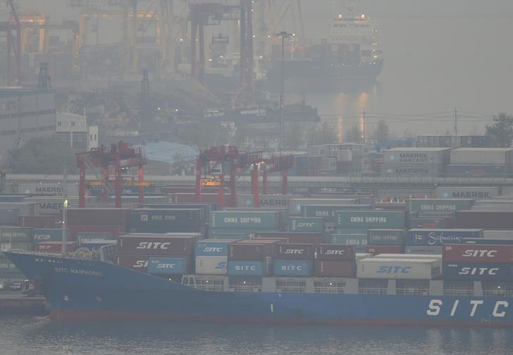 Containers are seen at a port in Incheon, west of Seoul May 9, 2013.  REUTERS/Lee Jae-Won