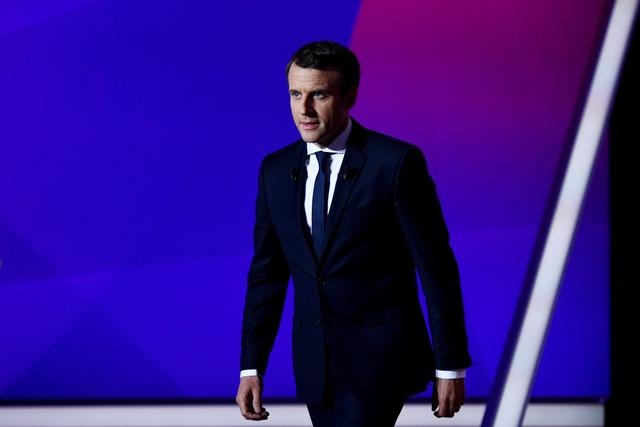 Emmanuel Macron, head of the political movement En Marche!, or Onwards!, and candidate for French 2017 presidential election, attends the France 2 television special prime time political show, ''15min to Convince'' in Saint-Cloud, near Paris, France, April 20, 2017. REUTERS/Martin Bureau/Pool