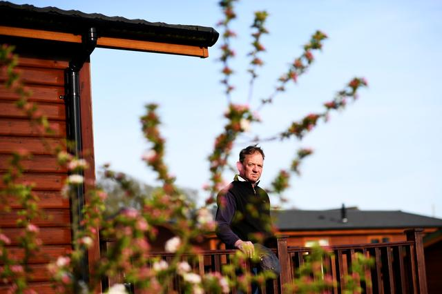 Scott McCready looks out from one of his holiday cabins at Briar Hill in Newton Ferrers, Devon, Britain April 11, 2017. REUTERS/Dylan Martinez