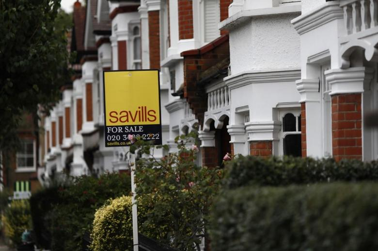 A Savills property estate agent sign is displayed outside a home in south London, Britain September 20, 2016.  REUTERS/Stefan Wermuth