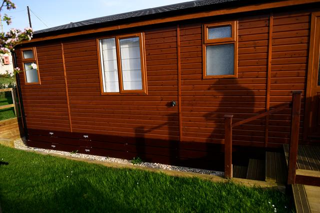 The sun shines on a mobile holiday cabin at Briar Hill in Newton Ferrers, Devon, Britain April 11, 2017. REUTERS/Dylan Martinez