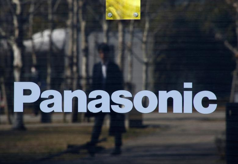 A man is reflected on Panasonic Corp's logo at Panasonic Center in Tokyo, Japan, February 2, 2017.  REUTERS/Kim Kyung-Hoon