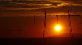 The sun sets behind electric power transmission lines near the town of Sachkhere, some 200 km (124 miles) north-west of Tbilisi, September 13, 2013. REUTERS/David Mdzinarishvili (GEORGIA - Tags: ENERGY SOCIETY BUSINESS)