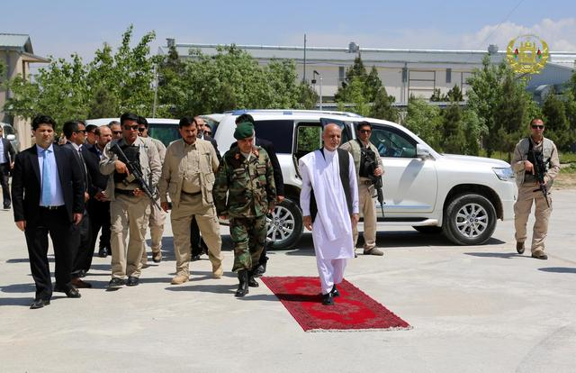 Afghanistan's President Ashraf Ghani (R) arrives to visit the victims of April 21's attack on an army headquarters, in Mazar-i-Sharif, northern Afghanistan April 22, 2017. Presidential Palace /Handout via REUTERS