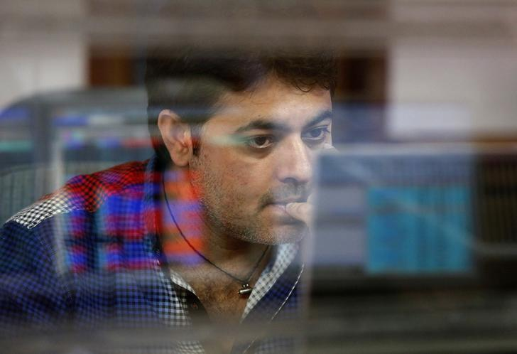 A broker reacts while trading at his computer terminal at a stock brokerage firm in Mumbai, India, February 26, 2016. REUTERS/Shailesh Andrade/File Photo