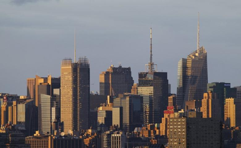 FILE PHOTO: The skyline of midtown Manhattan in New York is seen at sunset from Jersey City, New Jersey June 3, 2012. REUTERS/Gary Hershorn