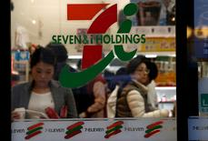 FILE PHOTO: People are seen at Seven & i Holdings Co's Seven Eleven convenience store in Tokyo, Japan January 12, 2017. REUTERS/Kim Kyung-Hoon/File Photo