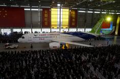 FILE PHOTO: The first C919 passenger jet made by the Commercial Aircraft Corp of China (Comac) is pulled out during a news conference at the company's factory in Shanghai, November 2, 2015.  REUTERS/Stringer/File Photo