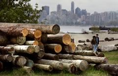 FILE PHOTO: A pile of cut logs sit on Spanish Banks in Vancouver, British Columbia, Canada, on April 26, 2006.    REUTERS/Andy Clark/File Photo