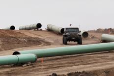 FILE PHOTO: A vehicle drives next to a series of pipes at a Dakota Access Construction site near the town of Cannon Ball, North Dakota, U.S., on October 30, 2016. REUTERS/Josh Morgan/File Photo