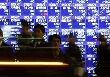 La Bourse de Tokyo a clôturé en nette hausse mardi, dans le sillage de la progression de Wall Street la veille, l'indice Nikkei repassant le seuil des 19.000 points pour la première fois depuis trois semaines. L'indice Nikkei a gagné 203,45 points (+1,08%) à 19.079,33 points. /Photo d'archives/REUTERS/Issei Kato
