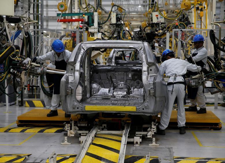 Workers are seen assembling a Mitsubishi Pajero at the Mitsubishi car factory in Bekasi, West Java province, Indonesia April 25, 2017. REUTERS/Beawiharta