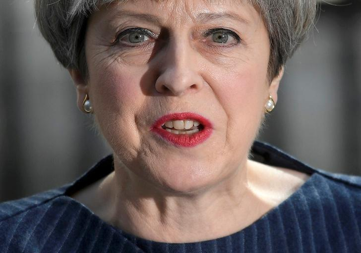 FILE PHOTO: Britain's Prime Minister Theresa May speaks to the media outside 10 Downing Street, in London, Britain April 18, 2017. REUTERS/Toby Melville/File Photo