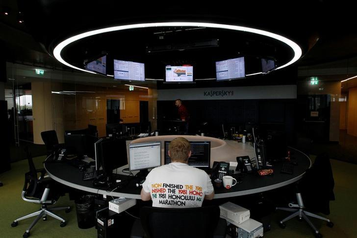 An employee works near screens in the virus lab at the headquarters of Russian cyber security company Kaspersky Labs in Moscow July 29, 2013. REUTERS/Sergei Karpukhin/File Photo