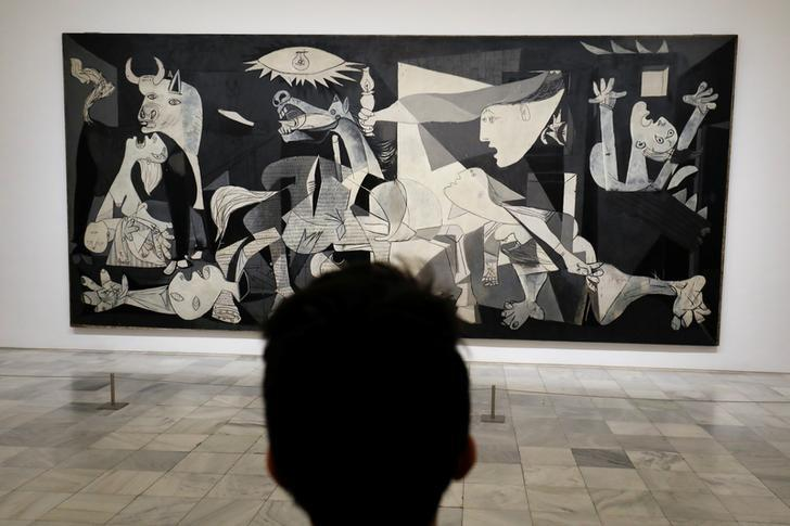 A man looks at Spanish artist Pablo Picasso's masterpiece ''Guernica'' at Madrid's Reina Sofia museum, April 3, 2017. REUTERS/Juan Medina