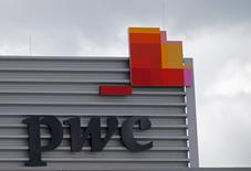 FILE PHOTO: The logo of PricewaterhouseCoopers is seen on the local offices building of the company in Luxembourg, April 26, 2016. REUTERS/Vincent Kessler/File Photo