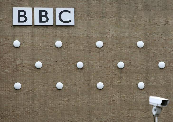 A British Broadcasting Corporation (BBC) logo is seen on a building in White City, London October 17, 2007.  REUTERS/Stephen Hird/Files