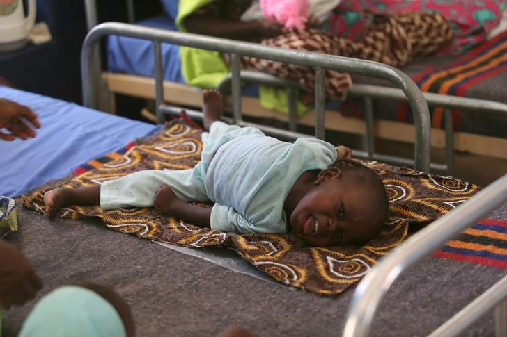 A child who is suffering brain damage resulting from Cerebral Spinal Meningitis is seen at the Save the Children stabilisation ward in Maiduguri, Nigeria November 30, 2016. REUTERS/Afolabi Sotunde/File Photo