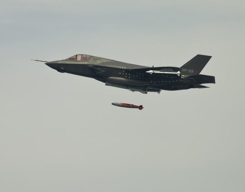 FILE PHOTO: BF-3, a short take-off and vertical landing F-35 Lightning II, releases an inert 1,000 lb. GBU-32 Joint Direct Attack Munition (JDAM) separation weapon over water in an Atlantic test range in Patuxent River, Maryland August 8, 2012.  REUTERS/Layne Laughter/Lockheed Martin/Handout