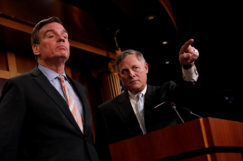 Senate Intelligence Committee Chairman Sen. Richard Burr (R-NC), accompanied by Senator Mark Warner (D-VA), vice chairman of the committee, speaks at a news conference to discuss their probe of Russian interference in the 2016 election on Capitol Hill in Washington, D.C., U.S., March 29, 2017.  REUTERS/Aaron P. Bernstein
